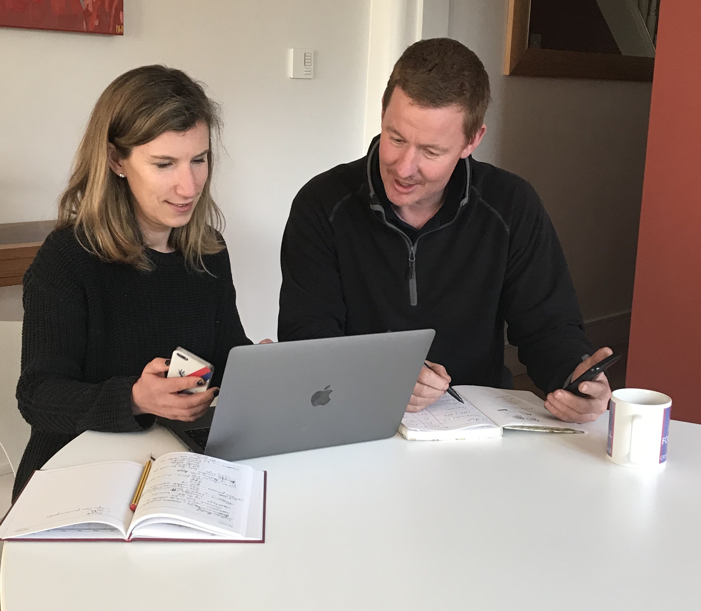 Anna from hellosocial.media working with a male client